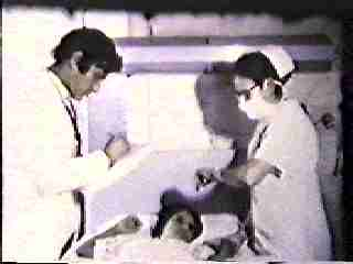 Donato 2 in late 1950s with nurse and patient